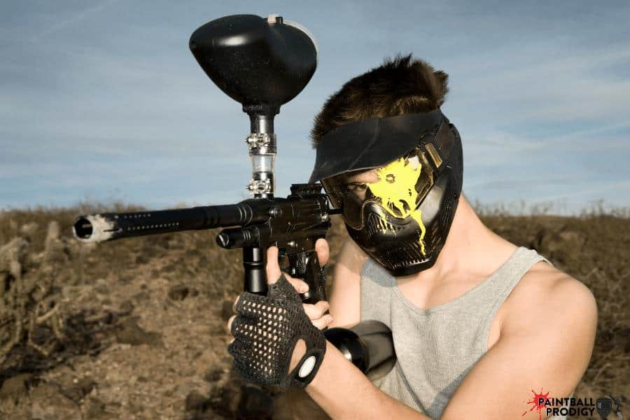 Shooting paintball at someone