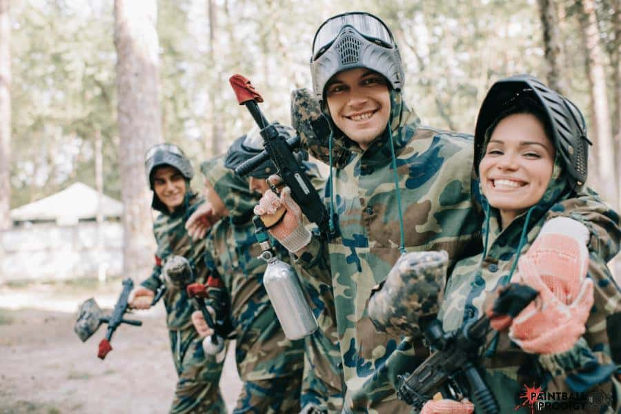 Friends having fun while playing paintball.